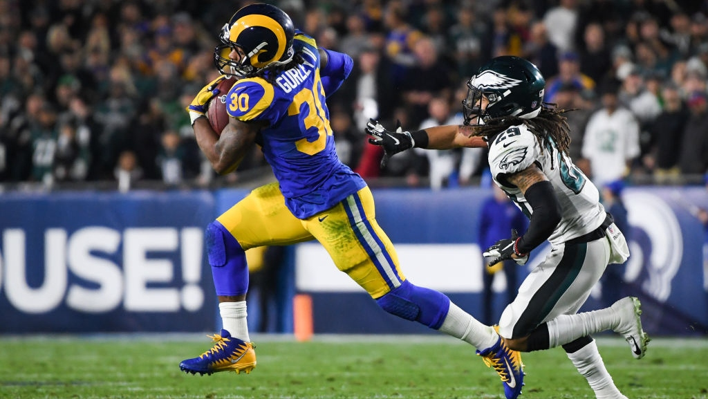 Running back Todd Gurley #30 of the Los Angeles Rams beats free safety Avonte Maddox #29 of the Philadelphia Eagles around the corner during the second quarter at Los Angeles Memorial Coliseum on December 16, 2018 in Los Angeles, California.