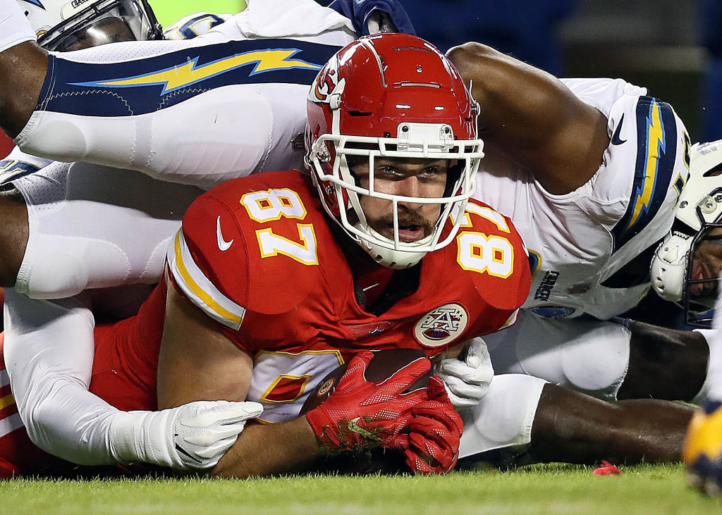 Tight end Travis Kelce #87 of the Kansas City Chiefs makes a catch against the Los Angeles Chargers at Arrowhead Stadium on December 13, 2018 in Kansas City, Missouri.
