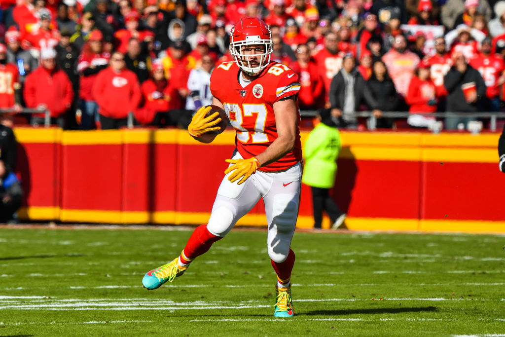 Travis Kelce #87 of the Kansas City Chiefs makes a catch in the open field during the second quarter of the game against the Baltimore Ravens at Arrowhead Stadium on December 9, 2018 in Kansas City, Missouri.