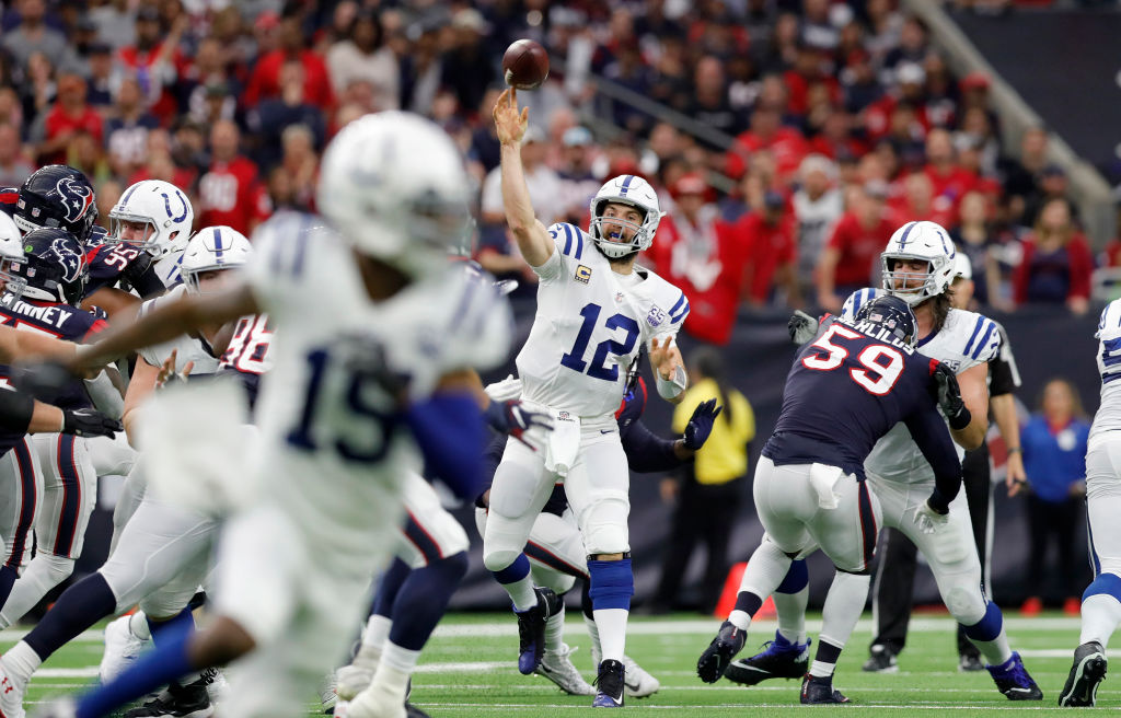 Andrew Luck #12 of the Indianapolis Colts throws a pass in the second quarter against the Houston Texans during the Wild Card Round at NRG Stadium on January 5, 2019 in Houston, Texas.