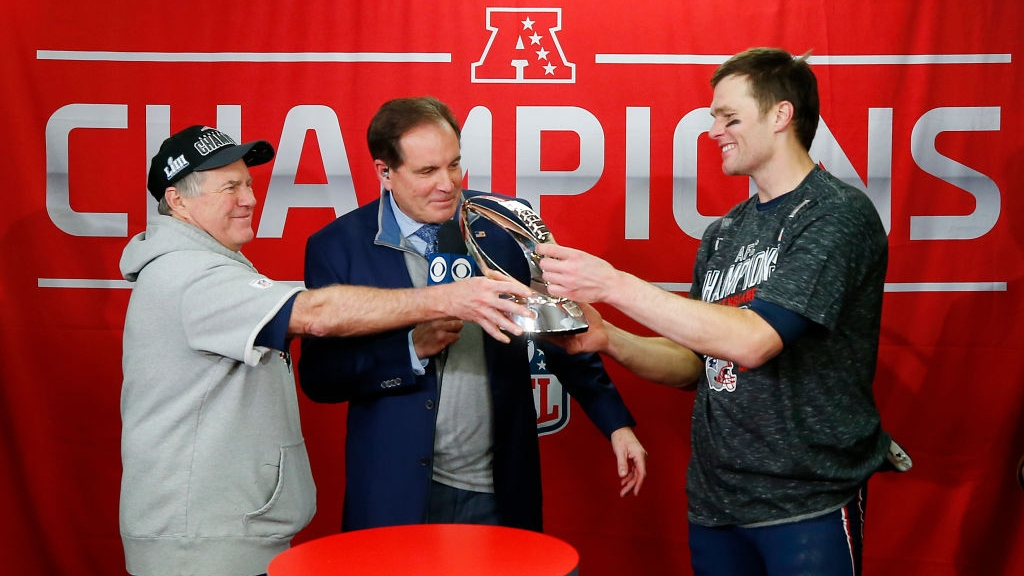 Head coach Bill Belichick of the New England Patriots hands the Lamar Hunt Trophy to Tom Brady #12 after defeating the Kansas City Chiefs during the AFC Championship Game at Arrowhead Stadium on January 20, 2019 in Kansas City, Missouri. The New England Patriots defeated the Kansas City Chiefs 37-31.