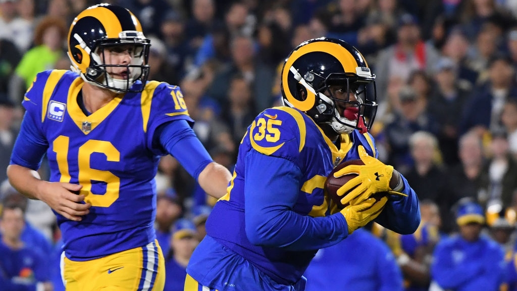 C.J. Anderson #35 of the Los Angeles Rams takes a handoff from Jared Goff #16 in the first quarter against the Dallas Cowboys in the NFC Divisional Playoff game at Los Angeles Memorial Coliseum on January 12, 2019 in Los Angeles, California.