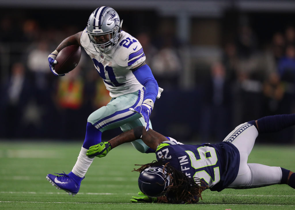 Ezekiel Elliott #21 of the Dallas Cowboys breaks a tackle attempt by Shaquill Griffin #26 of the Seattle Seahawks in the fourth quarter during the Wild Card Round at AT&T Stadium on January 05, 2019 in Arlington, Texas.