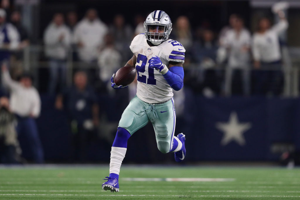 Ezekiel Elliott #21 of the Dallas Cowboys carries the ball against the Seattle Seahawks in the first half during the Wild Card Round at AT&T Stadium on January 05, 2019 in Arlington, Texas.