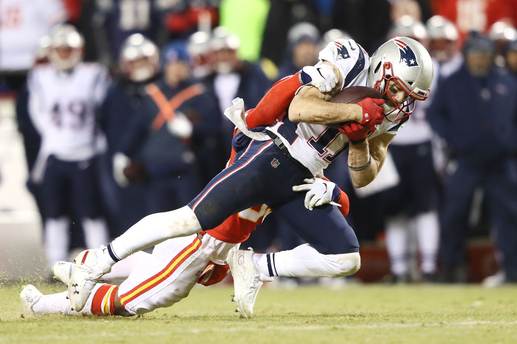 Julian Edelman #11 of the New England Patriots makes a catch in overtime against the Kansas City Chiefs during the AFC Championship Game at Arrowhead Stadium on January 20, 2019 in Kansas City, Missouri.