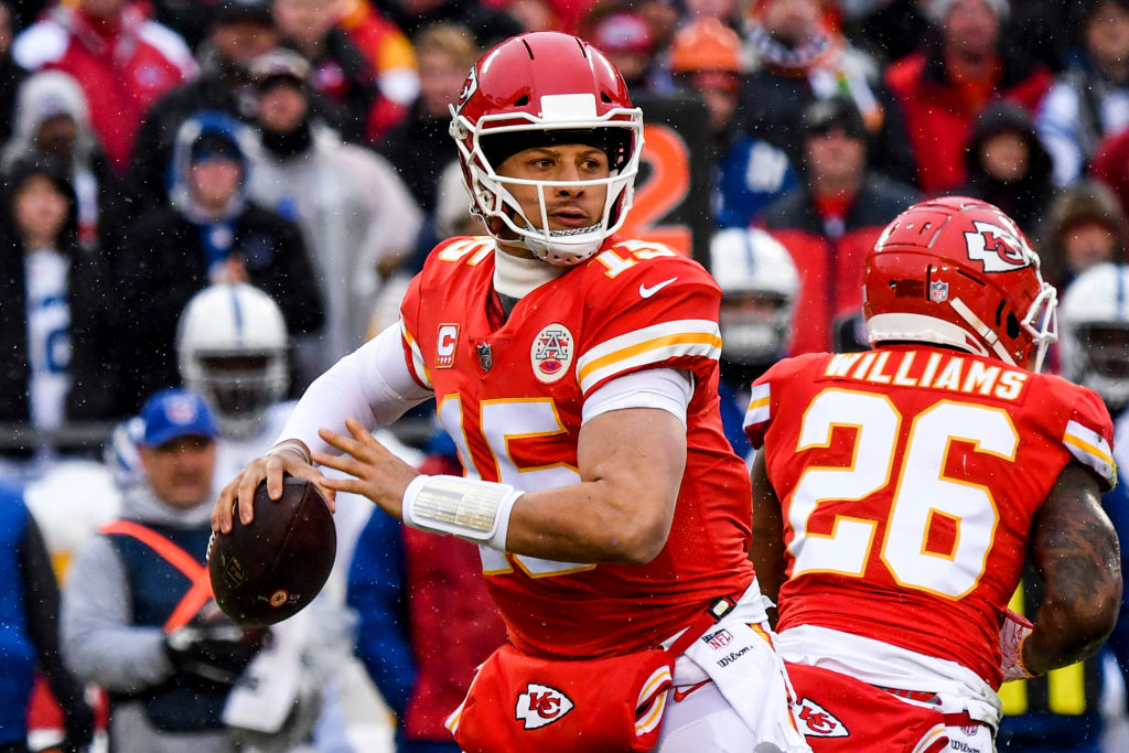 Patrick Mahomes #15 of the Kansas City Chiefs begins to throw a pass against the Indianapolis Colts during the first quarter of the AFC Divisional Round playoff game at Arrowhead Stadium on January 12, 2019 in Kansas City, Missouri.