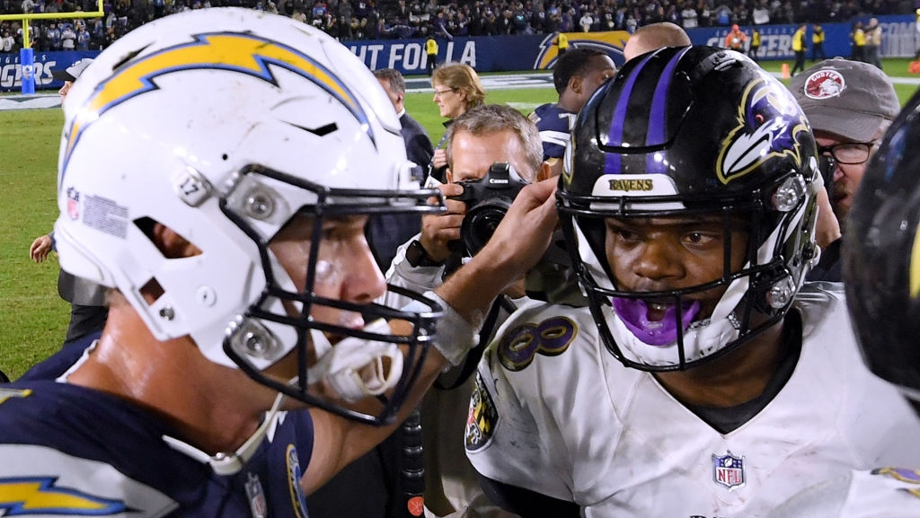Lamar Jackson #8 of the Baltimore Ravens and Philip Rivers #17 of the Los Angeles Chargers meet on the field after a 22-10 Ravens win at StubHub Center on December 22, 2018 in Carson, California.
