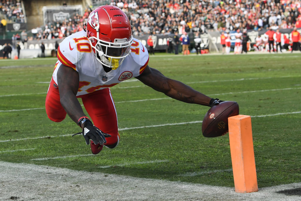 Tyreek Hill #10 of the Kansas City Chiefs dives short of the end zone against the Oakland Raiders during their NFL game at Oakland-Alameda County Coliseum on December 2, 2018 in Oakland, California.