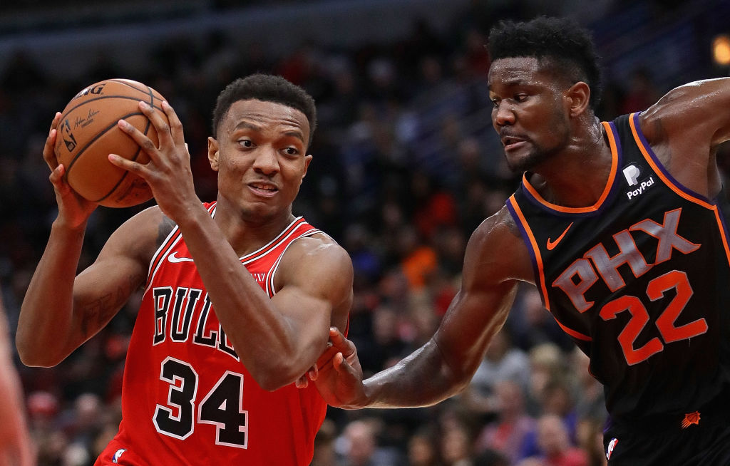 Wendell Carter Jr. #34 of the Chicago Bulls drives against Deandre Ayton #22 of the Phoenix Suns at the United Center on November 21, 2018 in Chicago, Illinois. The Bulls defeated the Suns 124-116.