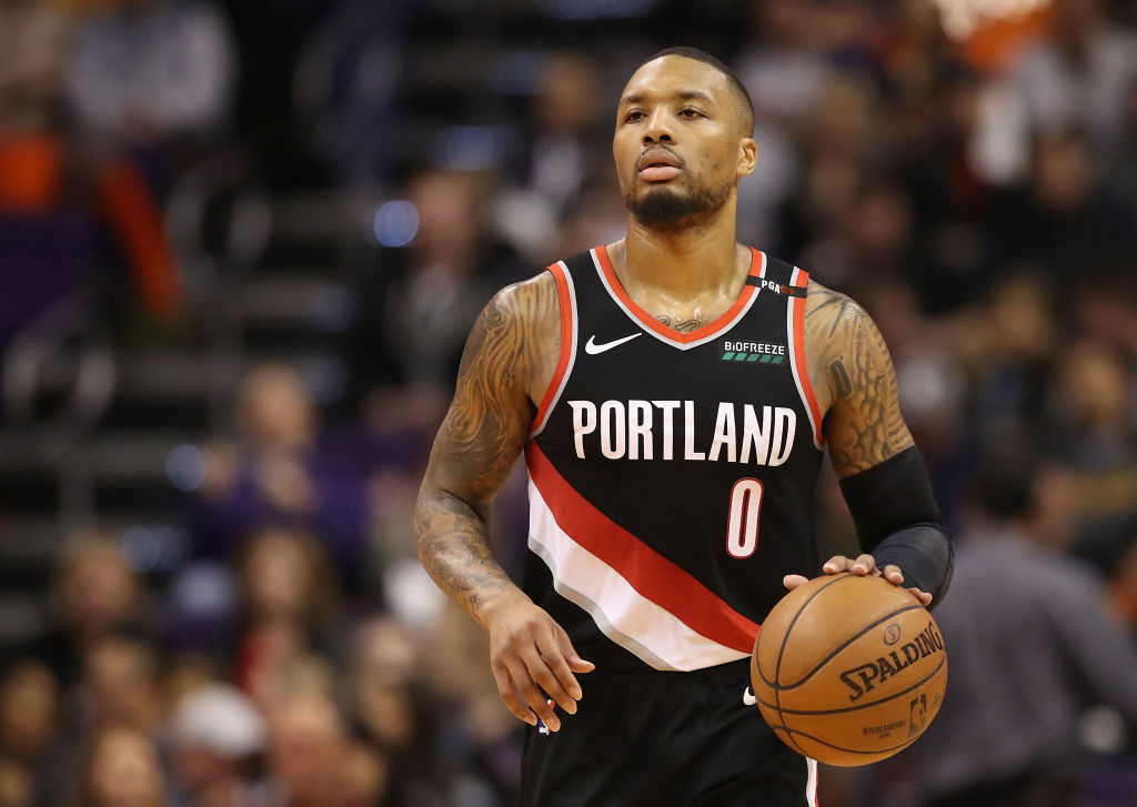 Damian Lillard #0 of the Portland Trail Blazers handles the ball during the second half of the NBA game against the Phoenix Suns at Talking Stick Resort Arena on January 24, 2019 in Phoenix, Arizona.