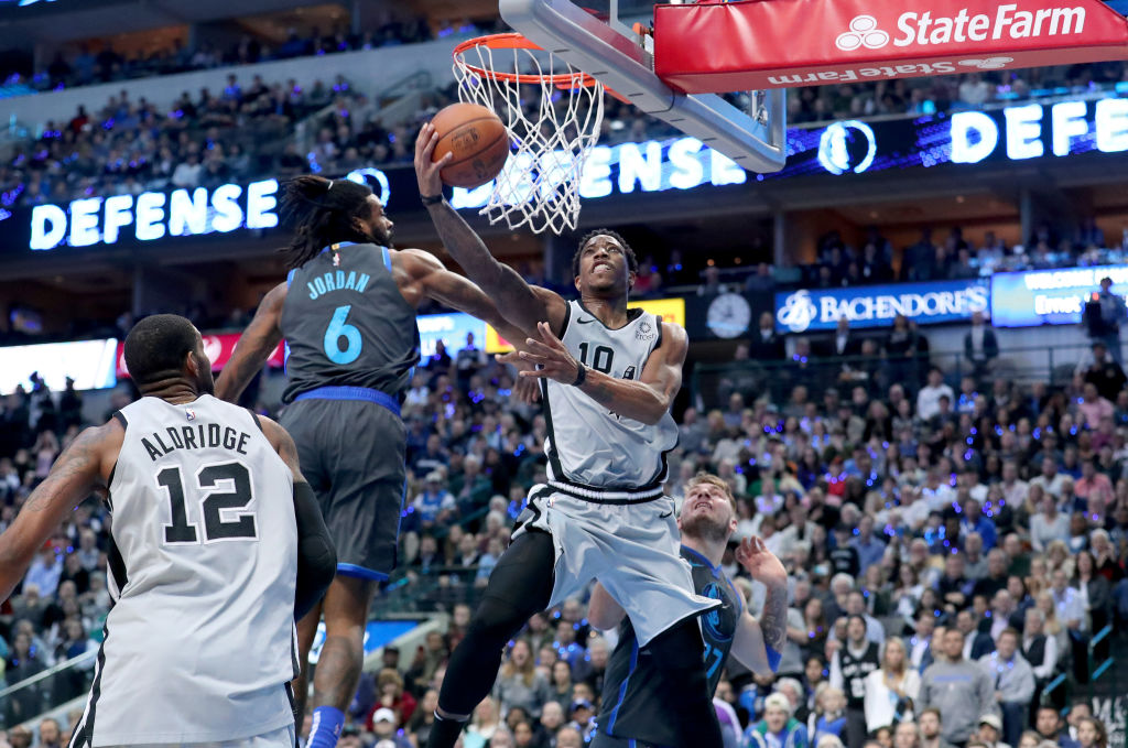 DeMar DeRozan #10 of the San Antonio Spurs drives to the basket against DeAndre Jordan #6 of the Dallas Mavericks in the second half at American Airlines Center on January 16, 2019 in Dallas, Texas.