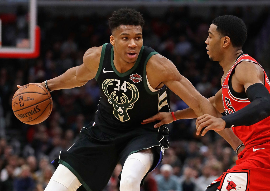 Giannis Antetokounmpo #34 of the Milwaukee Bucks moves against Shaquille Harrison #3 of the Chicago Bulls at the United Center on February 11, 2019 in Chicago, Illinois. The Bucks defeated the Bulls 112-99.
