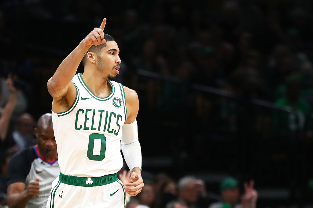 Jayson Tatum #0 of the Boston Celtics celebrates after scoring against the Charlotte Hornets during the first half at TD Garden on January 30, 2019 in Boston, Massachusetts.