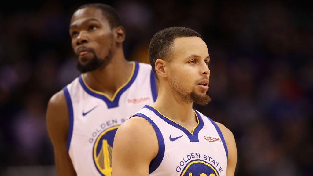 Stephen Curry #30 and Kevin Durant #35 of the Golden State Warriors during the first half of the NBA game against the Phoenix Suns at Talking Stick Resort Arena on February 08, 2019 in Phoenix, Arizona.
