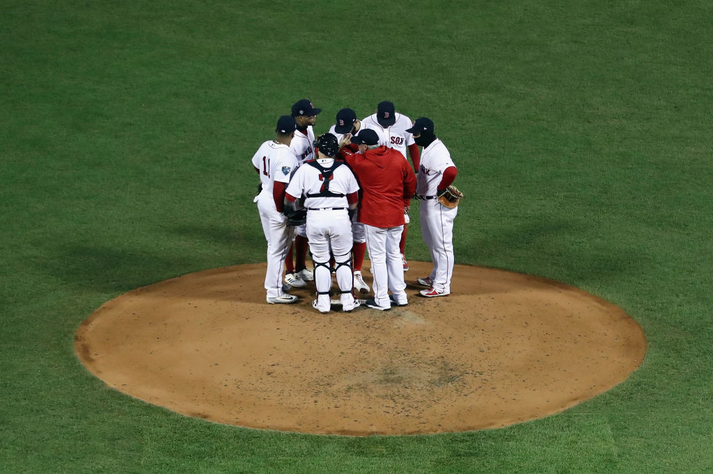 David Price #24 of the Boston Red Sox receives a mound visit during the fourth inning against the Los Angeles Dodgers in Game Two of the 2018 World Series at Fenway Park on October 24, 2018 in Boston, Massachusetts.