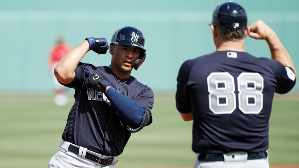 Gleyber Torres #25 of the New York Yankees reacts after hitting a solo home run in the first inning of a Grapefruit League spring training game against the Boston Red Sox at JetBlue Park at Fenway South on February 23, 2019 in Fort Myers, Florida.