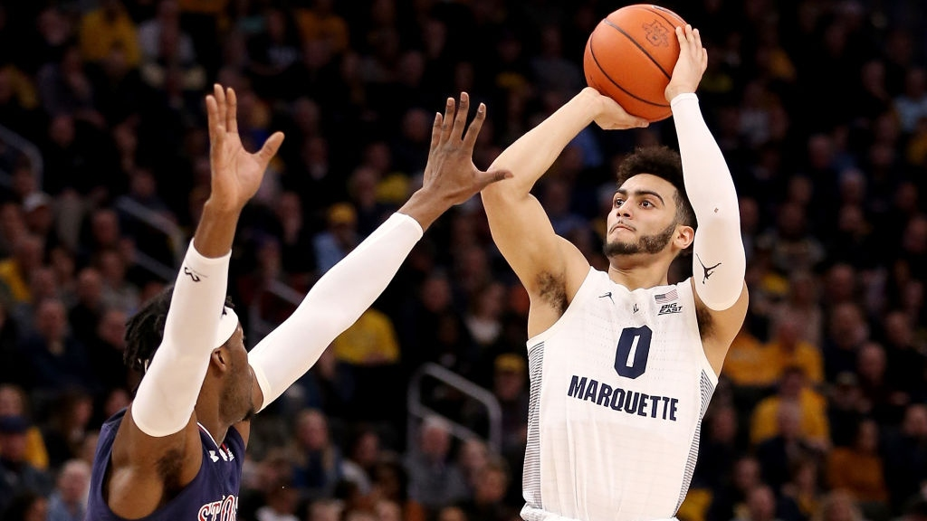 Markus Howard #0 of the Marquette Golden Eagles attempts a shot while being guarded by Sedee Keita #0 of the St. John's Red Storm in the first half at the Fiserv Forum on February 05, 2019 in Milwaukee, Wisconsin.