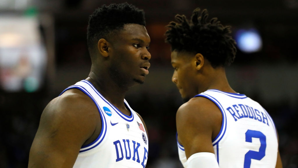 Zion Williamson #1 of the Duke Blue Devils talks with Cam Reddish #2 against the UCF Knights during the first half in the second round game of the 2019 NCAA Men's Basketball Tournament at Colonial Life Arena on March 24, 2019 in Columbia, South Carolina.