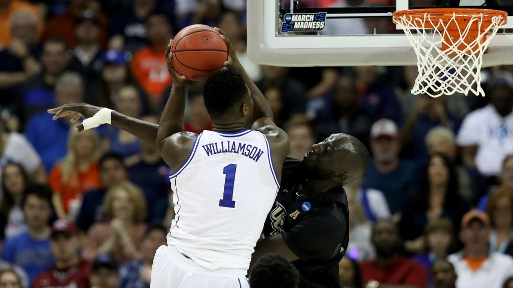 Tacko Fall #24 of the UCF Knights defends against Zion Williamson #1 of the Duke Blue Devils in the second round game of the 2019 NCAA Men's Basketball Tournament at Colonial Life Arena on March 24, 2019 in Columbia, South Carolina.