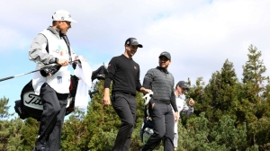 Adam Scott and Jason Day of Australia walk on the 3rd hole during the first round of the CJ Cup at the Nine Bridges on October 18, 2018 in Jeju, South Korea.