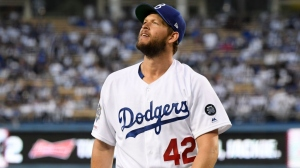 Clayton Kershaw #42 of the Los Angeles Dodgers reacts as he leaves the mound after the first inning on Jackie Robinson Day at Dodger Stadium on April 15, 2019 in Los Angeles, California. All players are wearing the number 42 in honor of Jackie Robinson Day.