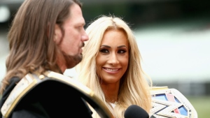 WWE'S world champion AJ Styles and Smackdown women's champion Carmella speak at the Melbourne Cricket Ground on June 24, 2018 in Melbourne, Australia.