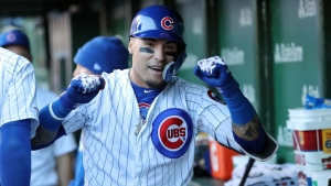 Javier Baez #9 of the Chicago Cubs celebrates in the dugout following his game winning home run during the eighth inning of a game against the St. Louis Cardinals at Wrigley Field on May 04, 2019 in Chicago, Illinois.