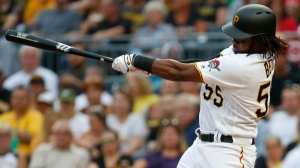 Josh Bell #55 of the Pittsburgh Pirates hits a RBI single in the first inning against the Cincinnati Reds at PNC Park on August 1, 2017 in Pittsburgh, Pennsylvania.