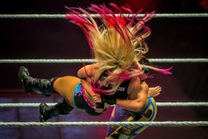 Alexa Bliss (L) and Bayley battle in the ring during the WWE show at Zenith Arena on may 09, 2017 in Lille, France.