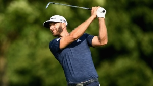 Dustin Johnson tees off during the final round at the RBC Canadian Open at Glen Abbey Golf Club on July 29, 2018 in Oakville, Canada.