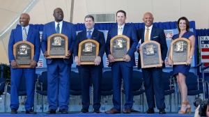 Inductees (from left) Harold Baines, Lee Smith, Edgar Martinez, Mike Mussina, Mariano Rivera and Brandy Halladay, wife the late Roy Halladay, pose with their plaques during the Baseball Hall of Fame induction ceremony at Clark Sports Center on July 21, 2019 in Cooperstown, New York.