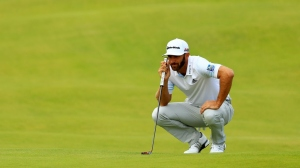 Dustin Johnson of the United States lines up a putt on the 2nd green during the second round of the 148th Open Championship held on the Dunluce Links at Royal Portrush Golf Club on July 19, 2019 in Portrush, United Kingdom.