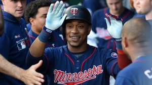 Jorge Polanco #11 of the Minnesota Twins celebrates his home run with teammates in the first inning against the Kansas City Royals at Kauffman Stadium on June 20, 2019 in Kansas City, Missouri.
