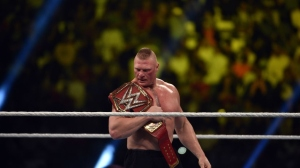 Brock Lesnar celebrates after winning the WWE Universal Championship match as part of as part of the World Wrestling Entertainment (WWE) Crown Jewel pay-per-view at the King Saud University Stadium in Riyadh on November 2, 2018.