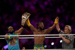 WWE Superstar Kofi Kingston (C) celebrates at the end of the World Wrestling Entertainment (WWE) Super Showdown event in Saudi Arabia's Red Sea port city of Jeddah late on January 7, 2019.