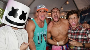 Marshmello, New England Patriots tight end Rob Gronkowski, Mojo Rawley, and Martin Garrix attend the SiriusXM Music Lounge at 1 Hotel South Beach on March 23, 2017 in Miami, Florida.