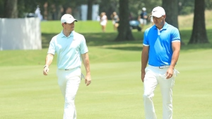 Brooks Koepka and Rory McIlroy of Northern Ireland walk to the green on the fourth hole during the final round of the World Golf Championship-FedEx St Jude Invitational at TPC Southwind on July 28, 2019 in Memphis, Tennessee.