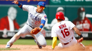 Kolten Wong #16 of the St. Louis Cardinals steals second base against Addison Russell #27 of the Chicago Cubs in the eighth inning at Busch Stadium on June 2, 2019 in St Louis, Missouri.
