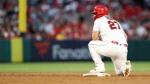 Mike Trout #27 of the Los Angeles Angels of Anaheim looks on after stealing second base during the second inning of a game against the Boston Red Sox at Angel Stadium of Anaheim on August 31, 2019 in Anaheim, California.