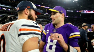 Mitchell Trubisky #10 of the Chicago Bears greets Kirk Cousins #8 of the Minnesota Vikings after the game at U.S. Bank Stadium on December 30, 2018 in Minneapolis, Minnesota. The Bears defeated the Vikings 24-10, knocking them out of playoff contention.