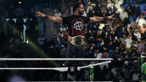Seth Rollins makes his way to the rign during the WWE World Cup Quarterfinal match as part of as part of the World Wrestling Entertainment (WWE) Crown Jewel pay-per-view at the King Saud University Stadium in Riyadh on November 2, 2018.