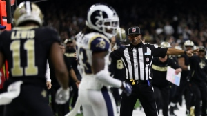 A referee watches as Tommylee Lewis #11 of the New Orleans Saints drops a pass broken up by Nickell Robey-Coleman #23 of the Los Angeles Rams during the fourth quarter in the NFC Championship game at the Mercedes-Benz Superdome on January 20, 2019 in New Orleans, Louisiana. at Mercedes-Benz Superdome on January 20, 2019 in New Orleans, Louisiana.